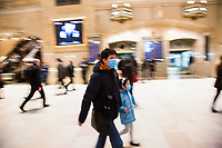 "NEW YORK, NEW YORK - MARCH 5: A man and a girl wear facial masks while walking fast at the Grand Central Terminal at rush hour on March 5, 2020. in New York City. New York State has 44 people in quarantine, some 4,000 people are in ""precautionary"" quarantine in more than two dozen counties, including more than 2,700 in the city and 1,000 in Westchester, Cuomo said. (Photo by Pablo Monsalve / VIEWpress via Getty Images)"