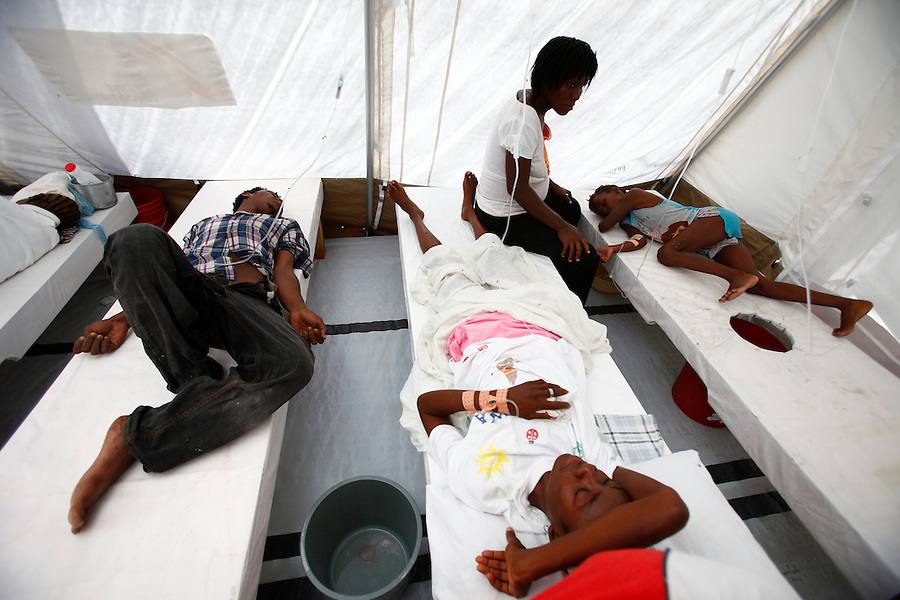 Nov 10, 2010 - Port-au-Prince, Haiti.Local residents suffering from cholera-like symptoms receive medical treatment in a small, crowded medical clinic set up in tents in the Cite Soleil area of Port-au-Prince, Haiti, Wednesday, November 10, 2010 as fears of a cholera outbreak spread through the area just two days after cases of the infection were confirmed in the area, the poorest slum in Haiti's capital. Officials from the Pan American Health Organization warn that Haiti's cholera epidemic, spread primarily through consuming infected water and food, is likely to grow much larger in the wake of Hurricane Tomas.  (Credit Image: Brian Blanco/ZUMA Press) 1