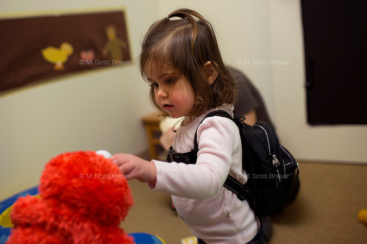 Madeline Wilson participates in an experiment in the Early Childhood Cognition Lab at MIT in Cambridge, Massachusetts, USA.  The backpack worn by Madeline holds a microphone that records her speech during the experiment.