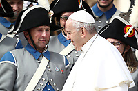 Papa Francesco saluta alcuni membri della soci&eacute;t&eacute; de musique &quot;Echo du Gibloux &quot; di Avry-devant-Pont in Svizzera al termine dell'udienza generale del mercoledi' in Piazza San Pietro, Citta' del Vaticano, 31 ottobre, 2018.<br /> Pope Francis walks past members of the Echo du Gibloux soci&eacute;t&eacute; de musique from Avry-devant-Pont in Switzerland at the end of  his weekly general audience in St. Peter's Square at the Vatican, on October 31, 2018. UPDATE IMAGES PRESS/Isabella Bonotto<br /> <br /> STRICTLY ONLY FOR EDITORIAL USE