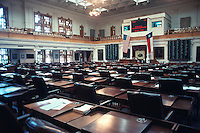 Vintage view of the House of Representatives Chamber, The Texas Capitol, May 1990. The House Chamber, the largest room in the Capitol, is located on the second floor west wing. When the building opened in 1888, the Chamber seated 106 members and now 150 representatives convene in the historic room which is the maximum allowed by the Texas Constitution - Stock Image.
