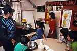 San Francisco CA Four-year-olds at Head Start preschool excited about making popcorn