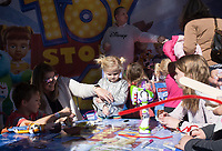 "NWA Democrat-Gazette/CHARLIE KAIJO Joshua Foitek, 6, (from left), Heather Foitek and Holly Foitek, 4, of Bentonville make ""Forkies"" at a Toystory booth, Friday, November 1, 2019 during the First Friday Toyland at the downtown square in Bentonville.<br /> <br /> The theme of this month's First Friday block party is Toyland. Kids had the opportunity to try out the latest toys."