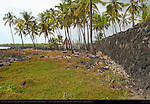 Great Wall, Hale o Keawe Heaiu, thatched Royal Mausoleum and Ki'i Guardians, Pu'uhonua o Honaunau, Place of Refuge, Pu'uhonua o Honaunau National Historical Park, South Kona Coast, Big Island of Hawaii