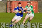 Sean Weir of St Senans breaks away from Ballyduff's Evan Doyle in The Bernard O'Callaghan Memorial Senior Football Championship quarter final replay last Sunday in Bob Stack Park, Ballybunion.