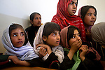 "School children react to seeing Afghan Public Protection Force (APPF) guardians and U.S. Special Forces operatives in their school, in Khan Ezzat village, Nerkh District, Wardak province, Afghanistan, Saturday, May 23, 2009. When the Special Forces team and APPF arrived to talk to the school principal and teachers, the children ran inside screaming and several began to cry. A grassroots-style pilot program, the APPF seeks to secure communities on the local level. The mission of the APPF program is to send the guardians back to their own villages to man checkpoints and conduct patrols, in an attempt to deny insurgent ""safe havens"" and extend the reach of the Afghan government. The United States government pays the guardians' salaries and provides vehicles and other equipment and U.S. Special Forces operatives facilitate and support the APPF checkpoints with the Afghan National Police and other Afghan agencies. While the guardians have been able to get established and begin work in Mayden Shahr and Jalrez districts, U.S. Special Forces and the APPF have met strong resistance in Nerkh district."