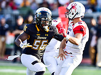 Baltimore, MD - OCT 14, 2017: Towson Tigers linebacker Diondre Wallace (56) in pursuit of Richmond Spiders quarterback Kyle Lauletta (5) during game between Towson and Richmond at Johnny Unitas Stadium in Baltimore, MD. The Spiders defeated the Tigers 23-3. (Photo by Phil Peters/Media Images International)