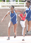 The Gazette Eleanor Roosevelt's Afia Charles receives the baton from Christian Hickson finishing first in the 4A 4x100 relay during the Maryland state track and field championships held at Morgan State University in Baltimore on Saturday.