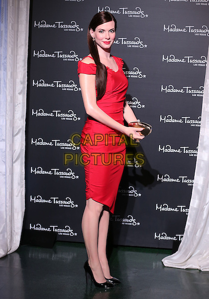 Sandra Bullock Figure.Extra TV's Adrianna Costa unveils wax figure of Sandra Bullock at Madame Tussauds inside The Venetian Las Vegas, Las Vegas, NV, USA, .24 January 2013..full length ruched black shoes gold clutch bag off the shoulders cutout shoulder waxwork wax work red   earring lipstick .CAP/ADM/MJT.© MJT/AdMedia/Capital Pictures.