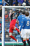 Allan McGregor makes a wonder save as he gets a strong paw on the ball to push it up and away to safety