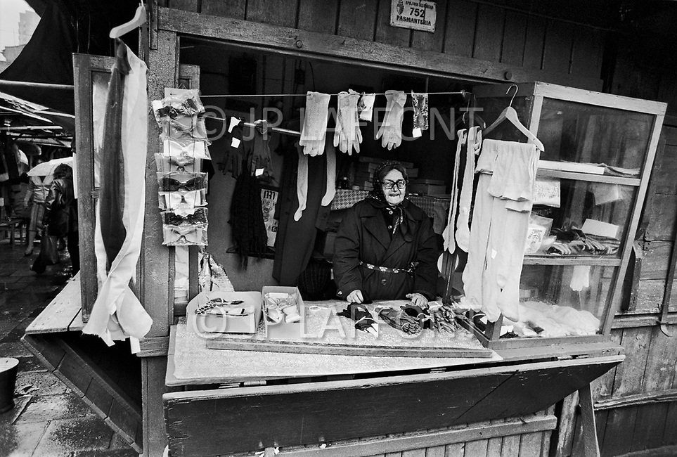 Poland, September, 1981  - A woman selling locally-made underwear, socks, and gloves in the main market of Warsaw.<br /> Pologne, septembre 1981- Une femme vendant Sous-v&ecirc;tements, chaussettes et gants fabriqu&eacute;s localement au march&eacute; principal de Varsovie.