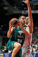 01.04.2012 SPAIN - ACB match played between Real Madrid vs Unicaja  at Palacio de los deportes stadium. The picture show Luka Zoric (Unicaja) and  Mirza Begic (Slovenian center of Real Madrid)