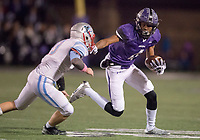 NWA Democrat-Gazette/CHARLIE KAIJO Fayetteville High School wide receiver Kris Mulinga (4) runs past a Southside High School defender during a playoff football game on Friday, November 10, 2017 at Fayetteville High School in Fayetteville.