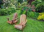 Vashon Island, WA: A pair of Adirondack chairs in a summer perennial garden; Froggsong Gardens