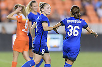 Houston, TX - Sunday Sept. 25, 2016: Kim Little celebrates scoring, Nahomi Kawasumi during a regular season National Women's Soccer League (NWSL) match between the Houston Dash and the Seattle Reign FC at BBVA Compass Stadium.