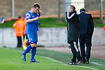 St Johnstone v Celtic.....12.04.11.Chris Millar leaves the pitch injured.Picture by Graeme Hart..Copyright Perthshire Picture Agency.Tel: 01738 623350  Mobile: 07990 594431