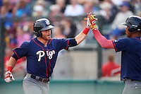 Lehigh Valley IronPigs third baseman Taylor Featherston (6) high fives Nick Williams (right) after a home run during a game against the Buffalo Bisons on July 9, 2016 at Coca-Cola Field in Buffalo, New York.  Lehigh Valley defeated Buffalo 9-1 in a rain shortened game.  (Mike Janes/Four Seam Images)