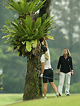 SINGAPORE - MARCH 07: Suzann Petterson of Norway retrives her ball from a tree on the par five 5th hole during the third round of HSBC Women's Champions at the Tanah Merah Country Club on March 7, 2009 in Singapore.  Photo by Victor Fraile / The Power of Sport Images