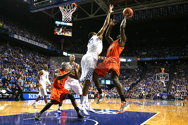 University of Pikeville guard Christian Leach (22) shoots the ball as Kentucky forward Karl-Anthony Towns (12) leaps to block it during the first half of exhibition game between Kentucky and Pikeville at Rupp Arena on Sunday, November 2, 2014 in Lexington, Ky. Kentucky leads Pikeville 67-37. Photo by Adam Pennavaria | Staff