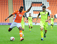 Blackpool's Jamille Matt under pressure from Exeter City's Jordan Moore-Taylor<br /> <br /> Photographer Kevin Barnes/CameraSport<br /> <br /> Football - The EFL Sky Bet League Two - Blackpool v Exeter City - Saturday 6th August 2016 - Bloomfield Road - Blackpool<br /> <br /> World Copyright &copy; 2016 CameraSport. All rights reserved. 43 Linden Ave. Countesthorpe. Leicester. England. LE8 5PG - Tel: +44 (0) 116 277 4147 - admin@camerasport.com - www.camerasport.com