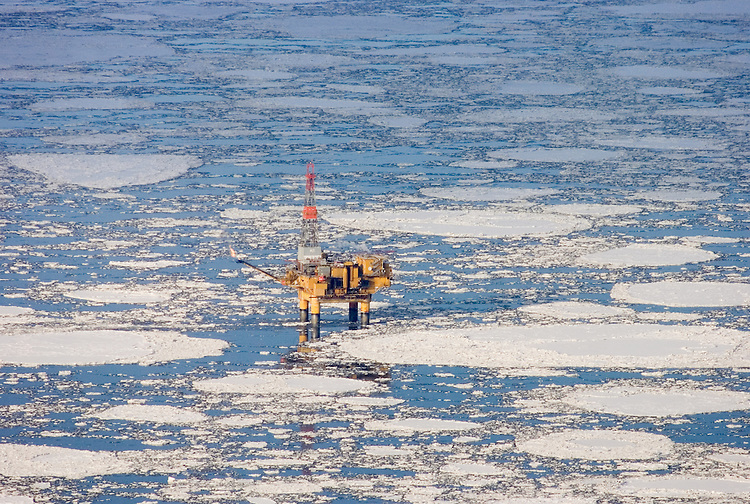 An oil industry platform stands among drifting pans of ice in Cook Inlet, offshore from Nikiski, Alaska. Oil and natural gas are an important contributor to the Kenai Peninsula's economy.