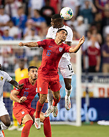 KANSAS CITY, KS - JUNE 26: Cristian Roldan #15 vie for a header Jose Fajardo #17 during a game between United States and Panama at Children's Mercy Park on June 26, 2019 in Kansas City, Kansas.