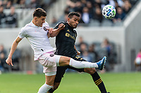 LOS ANGELES, CA - MARCH 01: Robbie Robinson #19 of Inter Miami CF advances the ball as Eddie Segura #4 of LAFC defends during a game between Inter Miami CF and Los Angeles FC at Banc of California Stadium on March 01, 2020 in Los Angeles, California.