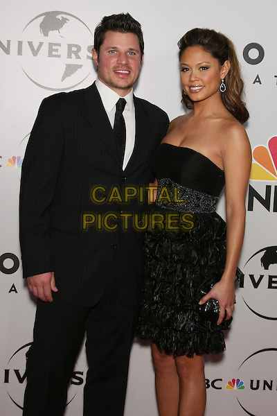 NICK LACHEY & VANESSA MINNILLO.The 2010 NBC, Universal Pictures & Focus Features' Annual Golden Globes After-Party at the Beverly Hilton, Beverly Hills, CA, USA.                                                                         January 17th, 2010.globes half 3/4 length black suit strapless dress clutch bag couple layers layered frills .CAP/LNC/AM.©Alba Montes/LNC/Capital Pictures