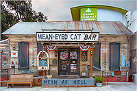 As an Austin Texas standard for many years, this photo of the Mean-Eye Cat Bar near downtown offers a nice contrast between old and new.