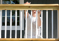 NWA Democrat-Gazette/DAVID GOTTSCHALK  James McAnear, of McAnear Painting of Bentonville, paints the railing of a deck Tuesday, September 29, 2015 of a home for painting in Bentonville. McAnear was painting the trim on both the interior and exterior of the home.