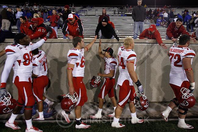 Chris Detrick  |  The Salt Lake Tribune .Utah Utes quarterback Jordan Wynn #3, center, and his teammates high-five their fans after the game at Falcon Stadium Saturday October 30, 2010.   Utah won the game 28-23.