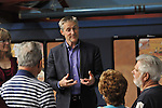 Erik Lindbergh, grandson of aviator Charles Lindbergh, participates in 85th anniversary celebration of his grandfather's historic solo flight across Atlantic, on Saturday May 19, 2012, at Cradle of Aviation museum, Long Island, New York. Significance of the 1927 flight of C. Lindbergh's Spirit of St. Louis which started at nearby Roosevelt Field, and ended at Le Bourget, France - was discussed, along with future of aviation, by panelists including Erik Lindbergh (purple shirt); plus, plaque commemorating the flight was rededicated. 10th anniversary of Cradle of Aviation opening and 35th anniversary of Charles A & Anne Morrow Lindberg Foundation were also celebrated.