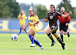 BROOKINGS, SD - AUGUST 13: Julia Lam #27 from South Dakota State chips the ball past Chelsea Dubiel #13 from Manitoba during the first half of their exhibition match Sunday afternoon at Fishback Soccer Park in Brookings. (Photo by Dave Eggen/Inertia)