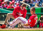 27 April 2014: Washington Nationals second baseman Danny Espinosa is attended to by Head Athletic Trainer Lee Kuntz after getting hit by an Ian Kennedy pitch leading off the bottom of the second inning against the San Diego Padres at Nationals Park in Washington, DC. The Padres defeated the Nationals 4-2 to to split their 4-game series. Mandatory Credit: Ed Wolfstein Photo *** RAW (NEF) Image File Available ***