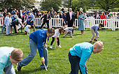 United States President Donald J. Trump and First Lady Melania Trump watch as children participate in the White House Easter Egg Roll at the White House in Washington, D.C. on April 22, 2019. <br /> Credit: Kevin Dietsch / Pool via CNP