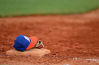 GCL Mets first baseman Dominic Smith (22) hat and glove sit on the base during the first game of a double header against the GCL Cardinals on July 17, 2013 at Roger Dean Complex in Jupiter, Florida.  GCL Cardinals defeated the GCL Mets 6-5 in twelve innings.  (Mike Janes/Four Seam Images)