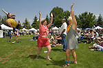 Women dance to the music at the annual Carson Valley Days celebration with food and entertainment at Lampe Park, Gardnerville, Nevada.