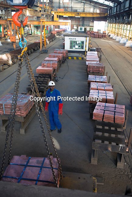 MUFULIRA, ZAMBIA- JULY 6: Workers move batches of copper sheets, which are stored in a warehouse and wait to be loaded on trucks on July 6, 2016 in Mufulira, Zambia. The copper is trucked to ports such as Dar es Salaam, Tanzania & Durban, South Africa. Glencore, an Anglo-Swiss multinational commodity trading and mining company. owns about 73 % of Mopani mines, which produces copper and some cobalt. The mine employs about 15,000 people. Many people in the area are dependent of the mines and its subcontractors for work. (Photo by Per-Anders Pettersson)