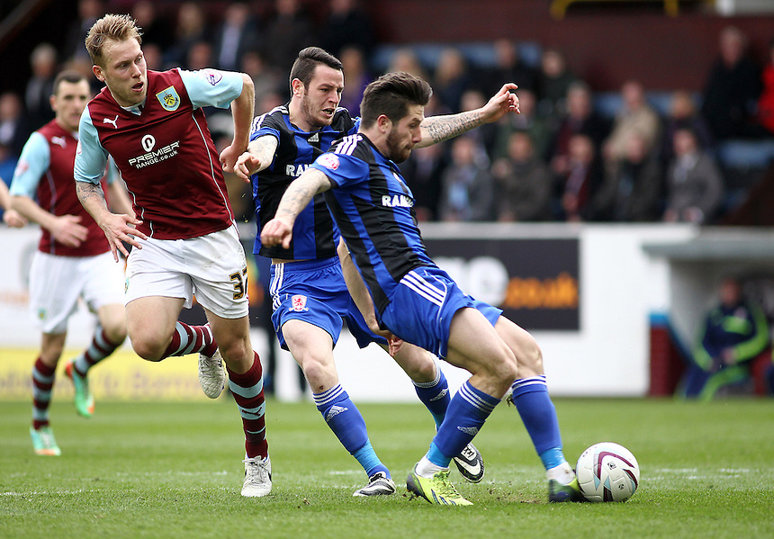 Middlesbrough's Jacob Butterfield scores the opening goal after a counter-attacking run by his team-mate Lee Tomlin (left)<br /> <br /> Photo by Rich Linley/CameraSport<br /> <br /> Football - The Football League Sky Bet Championship - Burnley v Middlesbrough - Saturday 12th April 2014 - Turf Moor - Burnley<br /> <br /> &copy; CameraSport - 43 Linden Ave. Countesthorpe. Leicester. England. LE8 5PG - Tel: +44 (0) 116 277 4147 - admin@camerasport.com - www.camerasport.com