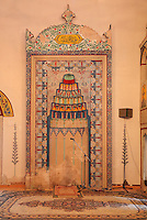 Decorative mihrab in the prayer hall of the Koski Mehmed Pasha mosque, built 1618, in Mostar, Bosnia and Herzegovina. The town is named after the mostari or bridge keepers of the Stari Most or Old Bridge. Mostar developed in the 15th and 16th centuries as an Ottoman frontier town and is listed as a UNESCO World Heritage Site. Picture by Manuel Cohen