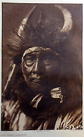 BNPS.co.uk (01202 558833)<br /> Pic: Bloomsbury/BNPS<br /> <br /> Bull Chief of the Apsaroke in 1908.<br /> <br /> Lost souls - Poignant archive reveals the lost tribes of North America in beautiful photographs from just over a century ago.<br /> <br /> A remarkable collection of photographs which give an unprecedented insight into the lives of Native Americans at a time when their land was being taken from them have emerged at auction.<br /> <br /> Between 1907 and 1930, US photographer Edward Curtis spent time with more than 80 native tribes across Native America, taking thousands of photographs as part of his groundbreaking The North American Indian project.<br /> <br /> A collection of more than 500 rare Curtis photographs are being auctioned off later this month and are expected to fetch over &pound;300,000.