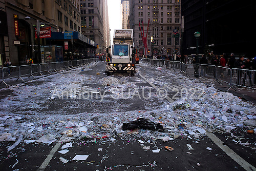 New York, New York<br /> February 7, 2012<br /> <br /> Cleaning up Broadway after the parade for the New York Giants who won the Super Bowl on Sunday against the New England Patriots.