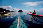 Sea kayakers, San Juan Islands,  paddliers the approaching Strawberry Island, Washington State, Pacific Northwest..