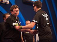21.12.2014.  London, England.  William Hill World Darts Championship.  Jamie Lewis [WAL] congratulates James Wade (6) [ENG] following their match. Wade won the match 3-1