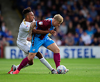 Scunthorpe United's Stephen Humphrys is fouled by Peterborough United's Rhys Bennett<br /> <br /> Photographer Chris Vaughan/CameraSport<br /> <br /> The EFL Sky Bet League One - Scunthorpe United v Peterborough United - Saturday 13th October 2018 - Glanford Park - Scunthorpe<br /> <br /> World Copyright &copy; 2018 CameraSport. All rights reserved. 43 Linden Ave. Countesthorpe. Leicester. England. LE8 5PG - Tel: +44 (0) 116 277 4147 - admin@camerasport.com - www.camerasport.com
