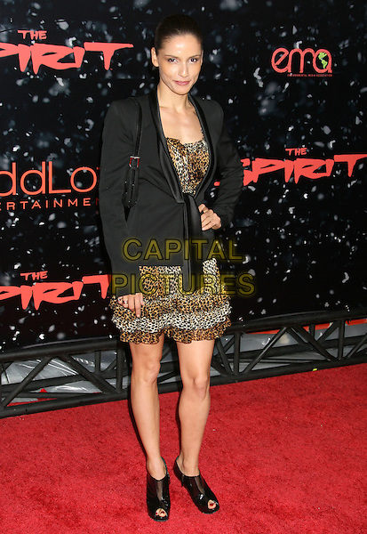 "LEONOR VARELA.""The Spirit"" Los Angeles Premiere held at Grauman's Chinese Theater, Hollywood, California, USA..December 17th, 2008.full length black brown leopard print dress jacket ankle open toe boots shoes layers layered hand on hip .CAP/ADM/MJ.©Michael Jade/AdMedia/Capital Pictures."