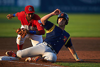 State College Spikes Cole Lankford (3) slides in as third baseman Kelvin Gutierrez looks to tag during a game against the Auburn Doubledays on July 6, 2015 at Falcon Park in Auburn, New York.  State College defeated Auburn 9-7.  (Mike Janes/Four Seam Images)