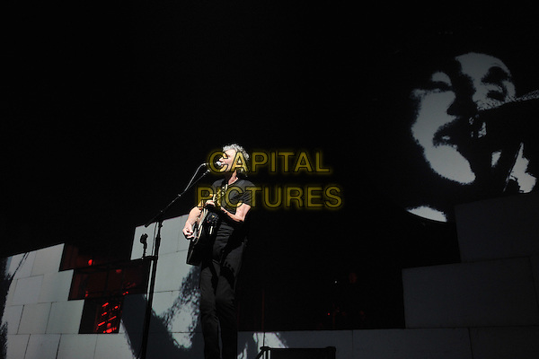 Roger Waters performing 'The Wall' in its entirety at Birmingham NIA (National Indoor Arena), England..27th June, 2011.on stage gig concert live performance music half length guitar black t-shirt jeans denim singing side profile .CAP/MAR.© Martin Harris/Capital Pictures.