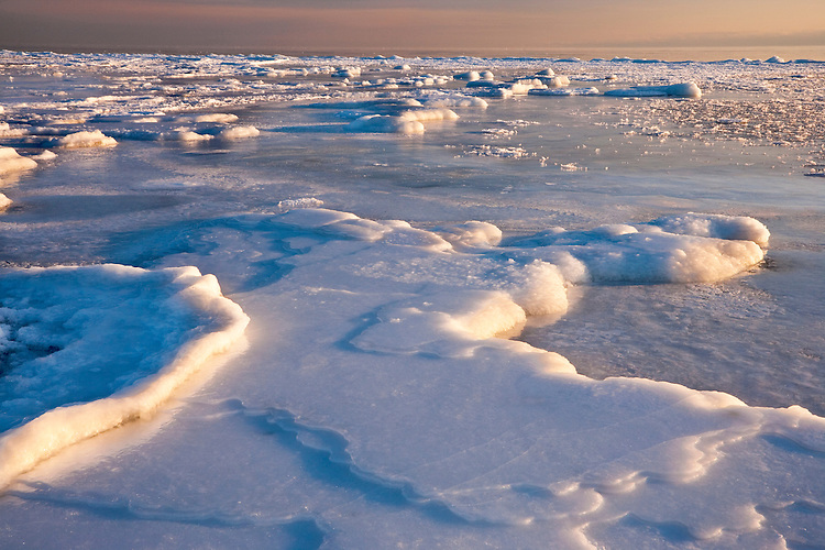 Sunrise light on ice formations on the shore of Lake Michigan at Cana Island; Door County, WI