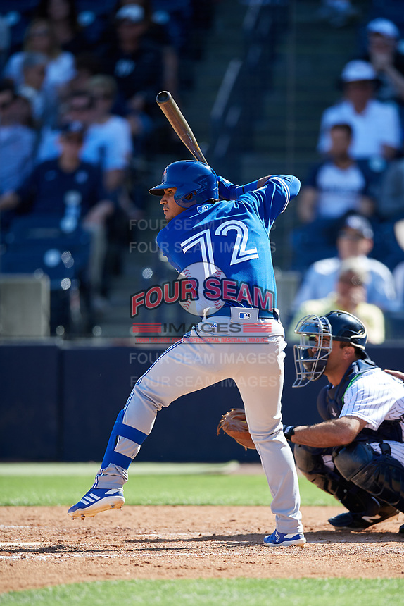 Toronto Blue Jays third baseman Santiago Espinal (72) at bat during a Grapefruit League Spring Training game against the New York Yankees on February 25, 2019 at George M. Steinbrenner Field in Tampa, Florida.  Yankees defeated the Blue Jays 3-0.  (Mike Janes/Four Seam Images)